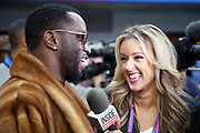 Sean John Combs, known professionally as P. Diddy, does a television interview on the field level with a female reporter from Inside Edition before the Philadelphia Eagles 2018 NFL Super Bowl LII football game against the New England Patriots on Sunday, Feb. 4, 2018 in Minneapolis. The Eagles won the game 41-33. (©Paul Anthony Spinelli)
