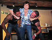 02.MARCH.2011. LIVERPOOL<br /> <br /> LIVERPOOL STUNTWOMAN EUNICE HURTART WHO DOUBLED FOR ANGELINA JOLIE GETS TO GRIP WITH TWO CHIPPENDALES NATE ESTHMADA AND DAVE ABRAMS AT THE GUSTO RESTAURANT IN THE ALBERT DOCK, LIVERPOOL.<br /> <br /> BYLINE: EDBIMAGEARCHIVE.COM<br /> <br /> *THIS IMAGE IS STRICTLY FOR UK NEWSPAPERS AND MAGAZINES ONLY*<br /> *FOR WORLD WIDE SALES AND WEB USE PLEASE CONTACT EDBIMAGEARCHIVE - 0208 954 5968*