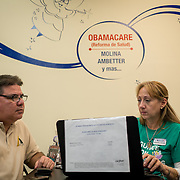 MIAMI, FLORIDA, NOVEMBER 16, 2016<br /> Manuel Hernandez, 49, consults with licensed insurance agent Marisabel Perdome at Sunshine Health and Life Advisors inside the Mall of the Americas in Miami Dade County. Customers have expressed concerns about &quot;Obama Care&quot; following the election of Donald Trump in the recent presidential elections.<br /> (Photo by Angel Valentin/Freelance)