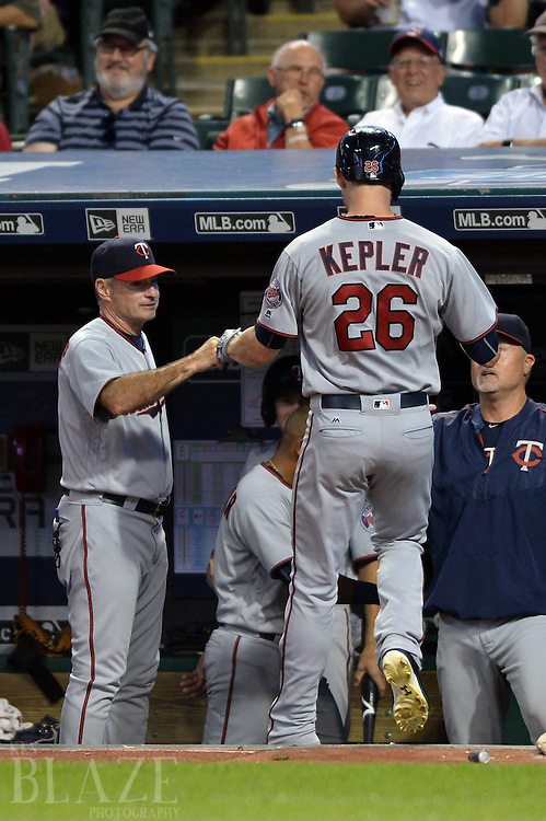 Aug 1, 2016; Cleveland, OH, USA; Minnesota Twins manager Paul Molitor (4) congratulates right fielder Max Kepler (26) after Kepler's third home run of the game during the sixth inning against the Cleveland Indians at Progressive Field. Mandatory Credit: Ken Blaze-USA TODAY Sports