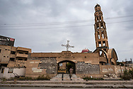 Soldiers guard the entrance to Saint George Church in Qaraqosh, a predominately Christian city near Mosul that was occupied and ravaged by ISIS from 2014 to 2016. The soldiers are Iraqi Christians, members of the Nineveh Plain Protection Units. (May 5, 2017)