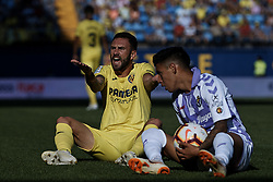 September 30, 2018 - Villarreal, Castellon, Spain - Miguel Arturo Layun Prado (L) of Villarreal CF reacts on the pitch next to Leo Suarez of Real Valladolid during the La Liga match between Villarreal CF and Real Valladolid at Estadio de la Ceramica on September 30, 2018 in Vila-real, Spain  (Credit Image: © David Aliaga/NurPhoto/ZUMA Press)