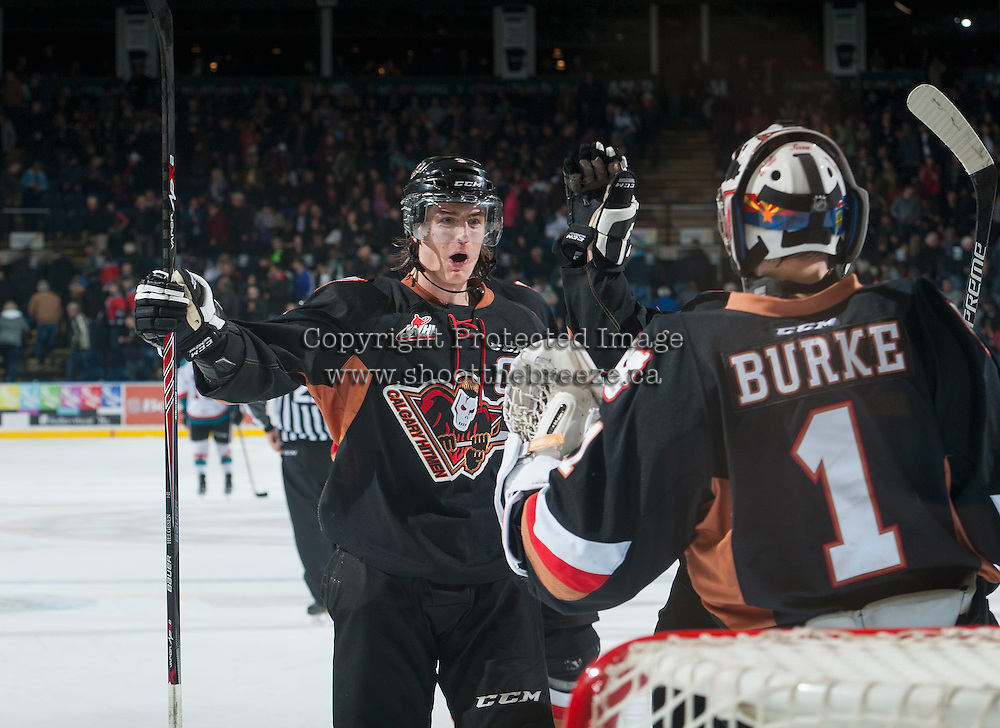KELOWNA, CANADA - FEBRUARY 28: Kenton Helgesen #3 congratulates Brendan Burke #1 of Calgary Hitmen on the win against the Kelowna Rockets on February 28, 2015 at Prospera Place in Kelowna, British Columbia, Canada.  (Photo by Marissa Baecker/Shoot the Breeze)  *** Local Caption *** Kenton Helgesen; Brendan Burke;