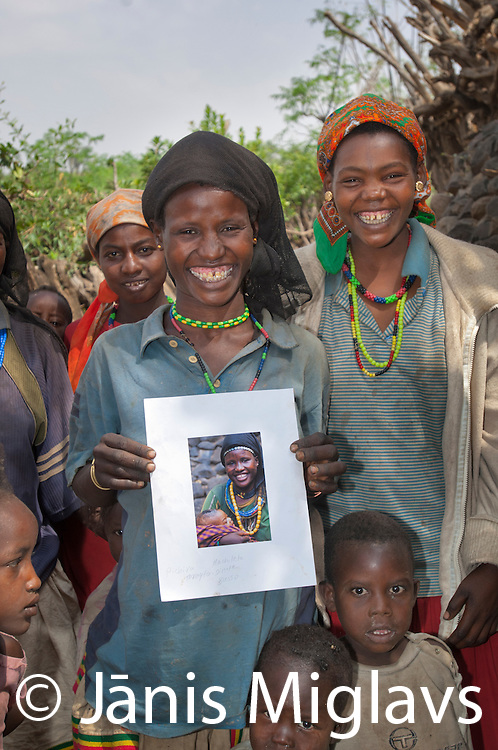 Pitchira Toraito holds a print of the photo I took of her and child in 2001 in Busso village, Konso tribe, Ethiopia.