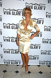 PAMELA ANDERSON at a party to celebrate Pamela Anderson's new role as spokesperson and newest face of the MAC Aids Fund's Viva Glam V Campaign held at Home House, Portman Square, London on 21st April 2005.<br /><br />NON EXCLUSIVE - WORLD RIGHTS