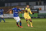 Eastleigh Hakeem Odoffin battleswith Southport FC Forward Jamie Allen during the Vanarama National League match between Southport and Eastleigh at the Merseyrail Community Stadium, Southport, United Kingdom on 17 December 2016. Photo by Pete Burns.