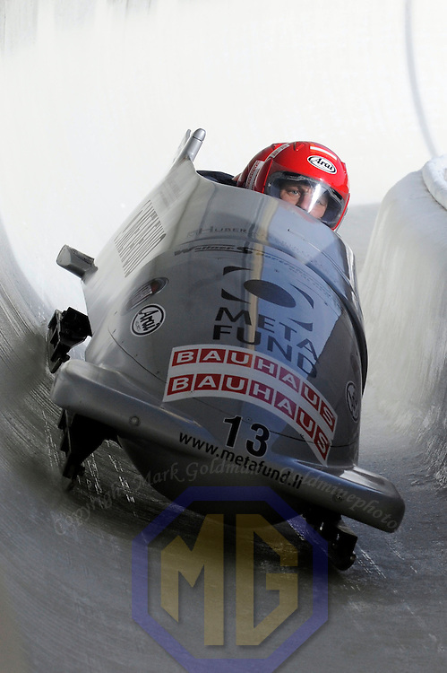01 March 2009:     The Austria 1 bobsled driven by Wolfgang Stampfer with sidepushers Juergen Mayer and Gerhard Koehler, and brakeman Juergen Loacker drives through turn 19 in the 3rd run at the 4-Man World Championships competition on March 1 at the Olympic Sports Complex in Lake Placid, NY.  The USA 1 bobsled driven by Steven Holcomb with sidepushers Justin Olsen and Steve Mesler, and brakeman Curtis Tomasevicz won the competition and the World Championship bringing the U.S. their first world championship since 1959 with a time of 3:36.61.