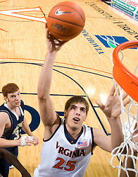 Virginia center John Brandenburg (25) gets a shot off against Shepherd.  The Virginia Cavaliers defeated the Shepherd Rams 87-52 in an NCAA basketball exhibition game at the University of Virginia's John Paul Jones Arena in Charlottesville, VA on November 9, 2008.