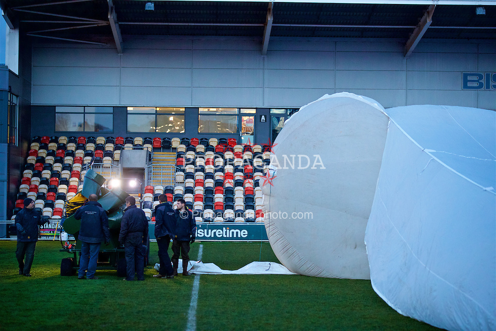 NEWPORT, WALES - Wednesday, December 21, 2016: Staff from Sport & Stadia Services prepare to remove a large inflated rain cover protects the Rodney Parade pitch ahead of the FA Cup 2nd Round Replay between Newport County AFC and Plymouth Argyle. (Pic by David Rawcliffe/Propaganda)