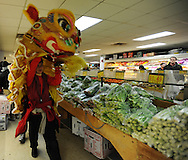 February 13, 2011 - Rev. Cheng Imm Tan, Gund Kwok troupe leader, performs a traditional Lion Dance inside C Market Supermarket as part of the Chinese New Year celebrations in Boston's China Town. The dance is done to herald in the new year and is thought to bring prosperity, peace and good luck.
