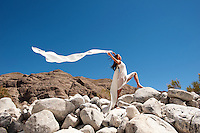 Beautiful asian woman in white holding a blowing scarf in a dramatic landscape.<br /> :::<br /> &quot;in reality we are accompanied by the whole dancing universe.&quot;<br /> -Ruth St. Denis