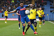 Sunderland defender Jordan Willis (4) battles for possession  with Oxford United forward Dan Agyei (23) during the EFL Sky Bet League 1 match between Oxford United and Sunderland at the Kassam Stadium, Oxford, England on 15 February 2020.