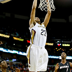 Oct 23, 2013; New Orleans, LA, USA; New Orleans Pelicans power forward Anthony Davis (23) dunks against the Miami Heat during the first half of a preseason game at New Orleans Arena. Mandatory Credit: Derick E. Hingle-USA TODAY Sports