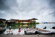 Small Boats And Dinghies Moored At With Salt House Restaurant In The Background. Cairns Boat Harbour. Cairns, Queensland, Australia. 31/05/2012. Photo By Lucas Wroe.