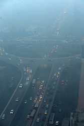 Vehicles line up in the street amid the heavy fog in Zhengzhou, capital of central China's Henan Province, Jan. 16, 2013. Affected by a cold front, the haze which has lingered in most parts of Henan for the past two weeks will begin to disperse on Jan. 17, 2013, according to the meteorological authority, China, January 16, 2013. Photo by Imago / i-Images...UK ONLY