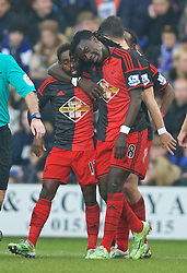 BIRKENHEAD, ENGLAND - Saturday, January 3, 2015: Swansea City's Nathan Dyer celebrates scoring the first goal against Tranmere Rovers with team-mate Bafetimbi Gomis during the FA Cup 3rd Round match at Prenton Park. (Pic by David Rawcliffe/Propaganda)