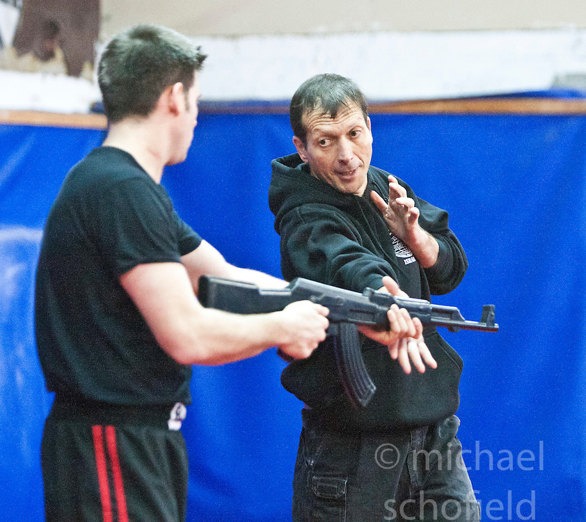 Avi Mayol, the Chairman of the International Krav Maga Federation (IKMF), takes students on day two on the Train & Travel in Israel, on Saturday 1st Jan 2011, at the Olympic shooting academy. Train & Travel is a unique ten day program designed for IKMF's instructors, students & guests, interested in combining Krav Maga training with a tour of the holy land. Saturday 1st Jan 2011 at the Olympic shooting academy..©2011 Michael Schofield. All Rights Reserved.