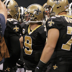 2008 December, 28: New Orleans Saints quarterback Drew Brees (9) leads a team chant on the field prior to kickoff of a week 17 game between NFC South divisional rivals the Carolina Panthers and the New Orleans Saints at the Louisiana Superdome in New Orleans, LA.