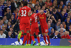 LONDON, ENGLAND - Friday, September 16, 2016: Liverpool's Adam Lallana celebrates the first goal against Chelsea scored by Dejan Lovren during the FA Premier League match at Stamford Bridge. (Pic by David Rawcliffe/Propaganda)