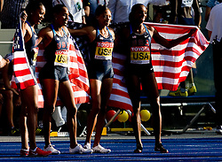 (L-R) Sanya Richards, Debbie Dunn, Allyson Felix and Lashinda Demus of the United States celebrate winning the gold medal in the women's 4x400 Metres Relay Finalduring day nine of the 12th IAAF World Athletics Championships at the Olympic Stadium on August 23, 2009 in Berlin, Germany. (Photo by Vid Ponikvar / Sportida)