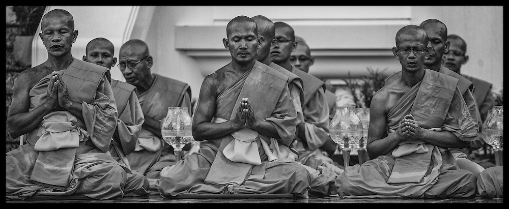 """Thai Buddhist monks offer prayers during ceremonies Monday, June 4, 2012,  at Wat Dhammakaya on the outskirts of Bangkok, Thailand.  Buddhist monks and the faithful gathered at temples throughout Thailand to celebrate Visakha Bucha or simply """"Vesak"""" which is a holiday celebrating the birth,.life, enlightenment, and passing of Gautama Buddha, the founder of Buddhism."""
