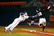 NEW TAIPEI CITY, TAIWAN - NOVEMBER 15:  Alan Schoenberger of #38 of Team Thailand avoids the tag of Cheng-Ming Peng #23 of Team Chinese Taipei in the top of the first inning of Game 2 of the 2013 World Baseball Classic Qualifier between Team New Zealand and Team Chinese Taipei at Xinzhuang Stadium in New Taipei City, Taiwan on Thursday, November 15, 2012.  Photo by Yuki Taguchi/WBCI/MLB Photos