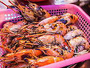 11 SEPTEMBER 2013 - BANGKOK, THAILAND: Grilled prawns ready to be served at Lek and Rut Seafood stand in the Chinatown section of Bangkok. Lek and Rut Seafood was one of the first street stall restaurants in Bangkok and is more of a pop up restaurant than a street food stall. It has sit down service and full menus, but seating is on the street and sidewalk and food is prepared in portable cookers that are brought out to the street when the restaurant opens. Thailand in general, and Bangkok in particular, has a vibrant tradition of street food and eating on the run. In recent years, Bangkok's street food has become something of an international landmark and is being written about in glossy travel magazines and in the pages of the New York Times.        PHOTO BY JACK KURTZ
