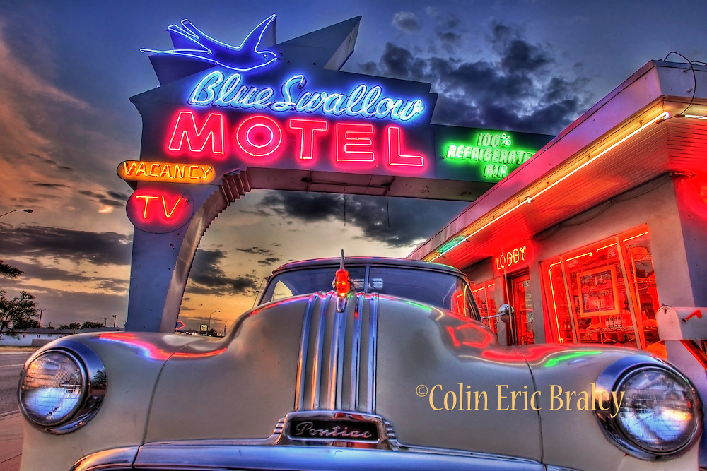 A vintage car and Art Deco neon light up The Blue Swallow Motel Along Route 66 in Tucumcari, New Mexico, Aug. 11, 2011. Colin E Braley/wildwest-media.com