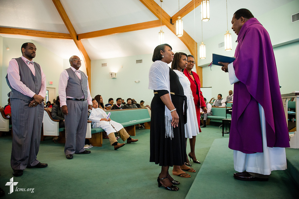 The Rev. Ulmer Marshall confirms Chelsea Pettaway (standing, center of row) during worship at Trinity Lutheran Church on Sunday, April 6, 2014, in Mobile, Ala. LCMS Communications/Erik M. Lunsford