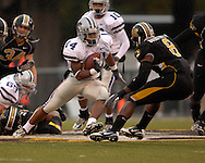 Kansas State running back Leon Patton (24) rushes up field against pressure from Missour safety David Overstreet (8) at Faurot Field in Columbia, Missouri, October 21, 2006.  The Tigers beat the Wildcats 41-21.<br />