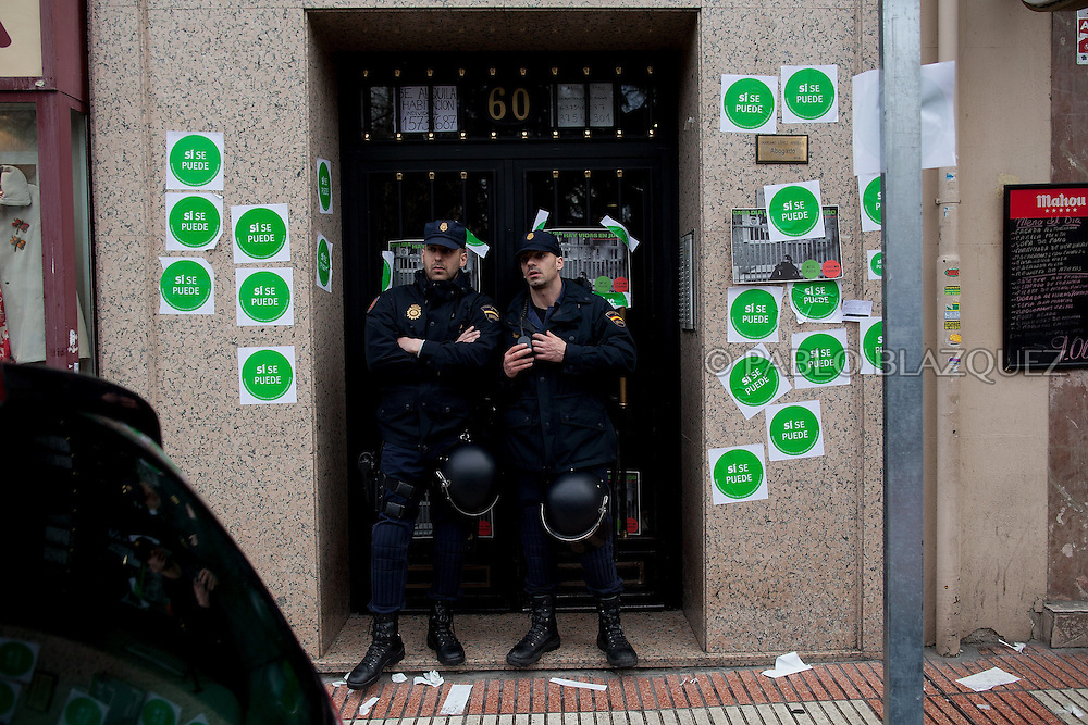 Riot police secures the building's entrance to the flat of Popular Party Deputy Mari Luz Prieto after anti-eviction activists took part in a 'escrache' or public denounce , on April 4, 2013 in Madrid, Spain. Placard reads 'Yes we can'. The Mortgage Holders Platform (PAH) and other anti evictions organizations are organizing 'escraches' for several weeks under the slogan 'There are lifes at risk' to claim the vote for a Popular Legislative Initiative (ILP) to stop evictions, regulate dation in payment and social rent outside Popular Party deputies' houses and offices..'Escraches' are form of peaceful public protest that was used in Argentine in 1995 to point to pardoned genocides of Argentenia's Dictatorship within their neighborhoods.