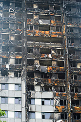 © Licensed to London News Pictures. 03/07/2017. London, UK. Fire damage to the cladding at Grenfell tower block in Notting Hill, west London where it is estimated that over 80 people died in a huge fire, believed to have been caused by a fridge fire which spread when the building cladding caught fire.. Photo credit: Andre Camara/LNP