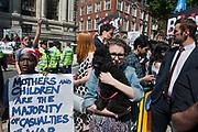 Girl Cuddles Dog at Demonstration , London, 1990s.