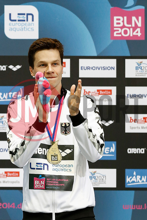 Patrick Hausding of Germany celebrates on the podium after winning Gold in the Mens 3m Springboard Final - Photo mandatory by-line: Rogan Thomson/JMP - 07966 386802 - 21/08/2014 - SPORT - DIVING - Berlin, Germany - SSE im Europa-Sportpark - 32nd LEN European Swimming Championships 2014 - Day 9.