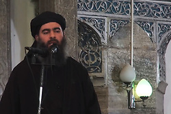 Photo taken from a video shows Islamic State of Iraq and Levant (ISIL or ISIS) leader Ibrahim Al-Badri, or Abu Bakr Al-Baghdadi, self appointed new Caliph named Caliph Ibrahim in the new proclaimed Islamic State, as he delivers a Friday sermon in the main mosque of Mosul, Iraq, on July 4, 2014. Photo by Balkis Press/ABACAPRESS.COM
