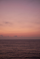 Pastel colored sky and clouds over the Pacific Ocean at dawn.  Image 8 of 21  for a panorama taken with a Fuji X-T1 camera and 35 mm f/1.4 lens  (ISO 400, 35 mm, f/2.8, 1/30 sec). Raw images processed with Capture One Pro and stitched together with AutoPano Giga Pro.