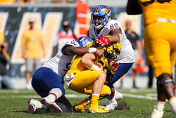 Oct 6, 2018; Morgantown, WV, USA; Kansas Jayhawks defensive tackle Daniel Wise (96) and Kansas Jayhawks defensive tackle J.J. Holmes (88) tackles West Virginia Mountaineers quarterback Will Grier (7) in the backfield during the fourth quarter at Mountaineer Field at Milan Puskar Stadium. Mandatory Credit: Ben Queen-USA TODAY Sports