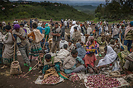 "Vendors sell local produce at the weekly market in a region recovering from drought.  The rains have arrived heavier than usual, ending the drought, but experts worry that the rains are so heavy that they may lead to crop failures.  This region in the Northern Ethiopian Highland have been rated by USAID as at risk of ""high"" to ""extreme"" food insecurity.  Lalibela, Ethiopia"
