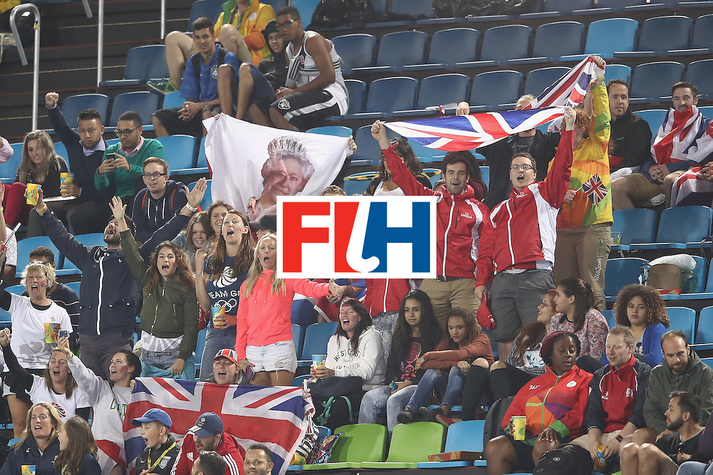 RIO DE JANEIRO, BRAZIL - AUGUST 10:  Great Britain supporters cheer during the men's pool A match between Great Britain and Australia on Day 5 of the Rio 2016 Olympic Games at the Olympic Hockey Centre on August 10, 2016 in Rio de Janeiro, Brazil.  (Photo by Mark Kolbe/Getty Images)