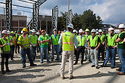 Engineering students touring the site of Walter Fieldhouse with Project Supervisor David Stanton at the Walter Fieldhouse Topping Off ceremony, October 2, 2013.