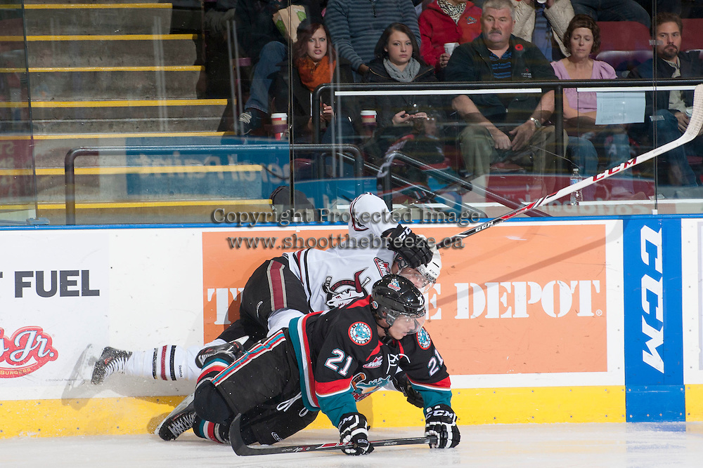KELOWNA, CANADA - NOVEMBER 6: Henrik Nyberg #21 of the Kelowna Rockets gets tangled at the boards with a player of the Red Deer Rebels on NOVEMBER 6, 2013 at Prospera Place in Kelowna, British Columbia, Canada.   (Photo by Marissa Baecker/Shoot the Breeze)  ***  Local Caption  ***