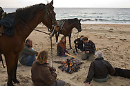 Corsica. France. Horse riding on the beach of Tradicetto , fire and bivouac  Corsica south  France    / randonnee a cheval sur la plage de Tradicetto, feu de camp et bivouac  Corse du sud  France  /