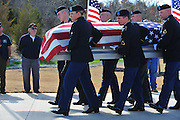 ACTION during the funeral for Army Pfc. Weldon Alonzo Davis, a Korean War soldier who died as a POW in 1951, at the Dallas-Fort Worth National Cemetery on Wednesday, February 6, 2013 in Dallas, Texas. (Cooper Neill/The Dallas Morning News)