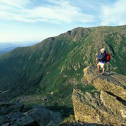 Mt. Washington, NH.A hiker takes in the view from Lion Head.  Boott Spur is in the distance across Tuckerman Ravine.  White Mountains National Forest.