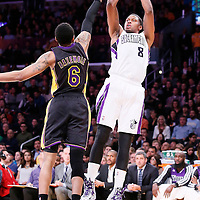 28 February 2014: Sacramento Kings small forward Rudy Gay (8) takes a jumpshot over Los Angeles Lakers shooting guard Kent Bazemore (6) during the Los Angeles Lakers 126-122 victory over the Sacramento Kings at the Staples Center, Los Angeles, California, USA.