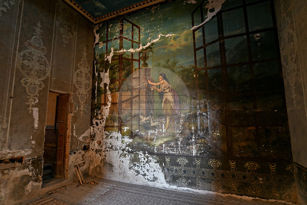 The painting of the Nymph llamada La Bathroom, painted in 1891 by N. González in the fading Hacienda de Jaral de Berrio in Jaral de Berrios, Guanajuato, Mexico. The abandoned Jaral de Berrio hacienda was once the largest in Mexico and housed over 6,000 people on the property and is credited with creating Mescal.