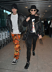 Singer Rita Ora and boyfriend Ricky Hilfiger at Heathrow airport in London, UK. 27/02/2015<br /> BYLINE MUST READ : GOTCHAIMAGES.COM<br /> <br /> Copyright by © Gotcha Images Ltd. All rights reserved.<br /> Usage of this image is conditional upon the acceptance <br /> of Gotcha Images Ltd, terms and conditions available at<br /> www.gotchaimages.com