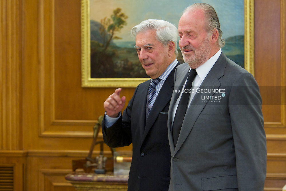 Spanish King Juan Carlos I attends an audience with Peruvian Nobel Prize Mario Vargas Llosa at Zarzuela Palace in Madrid