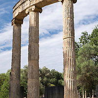 The UNESCO World Heritage Site of Ancient Olympia is a site on Greece's Peloponnese peninsula that hosted the original Olympic Games, founded in the 8th century B.C. Its extensive ruins include athletic training areas, a stadium, temples dedicated to the gods Hera and Zeus, and the Philippeion memorial (pictured here).