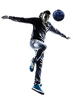 one  young man soccer freestyler player in silhouette on white background